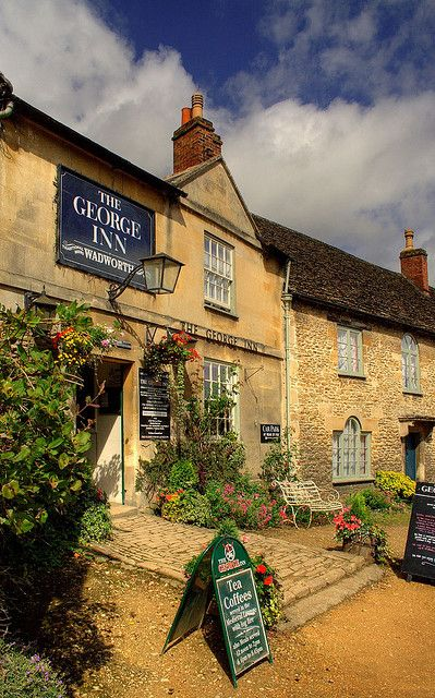 The George Inn, Lacock, Wiltshire, England.  Lacock is owned by the National Trust - including the shops, cafes and pubs.  It is often used as a film location for period film & TV productions.