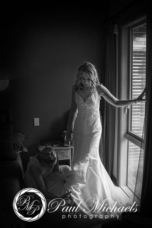 Bride getting ready by the window with bridesmaid. Silverstream retreat wedding venue. PaulMichaels wedding photography Wellington http://www.paulmichaels.co.nz/