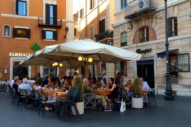 sitting outside at Ciampini in Rome in August