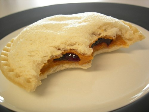 Uncrustables!  A good friend of mine at school always ate them and I was fascinated for such a long time by the shape and idea of such a simple sandwich.  Tried them for the first time today and the grape jelly alternative is the best choice for me.  Smuckers, I love ya'll!