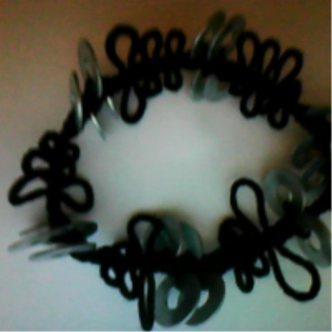Bracelet with knots and rings.