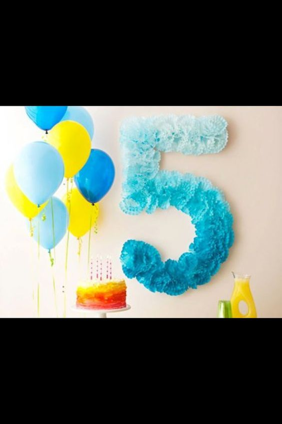 """Use coffee filters to make a wall number for your next birthday party, i did """"3"""" and left it white with a pink and tulle ribbon bow holding on the door"""