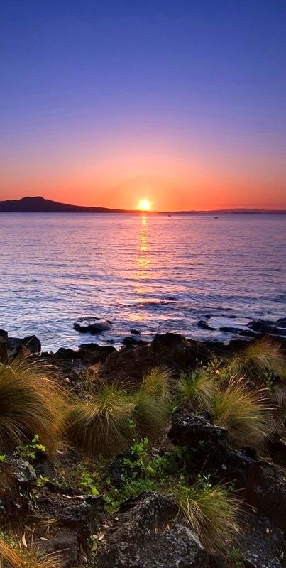 A view of Rangitito Island from Auckland's North Shore - New Zealand is known in the native Maori language as Aotearoa, often translated as The Land of the Long White Cloud.
