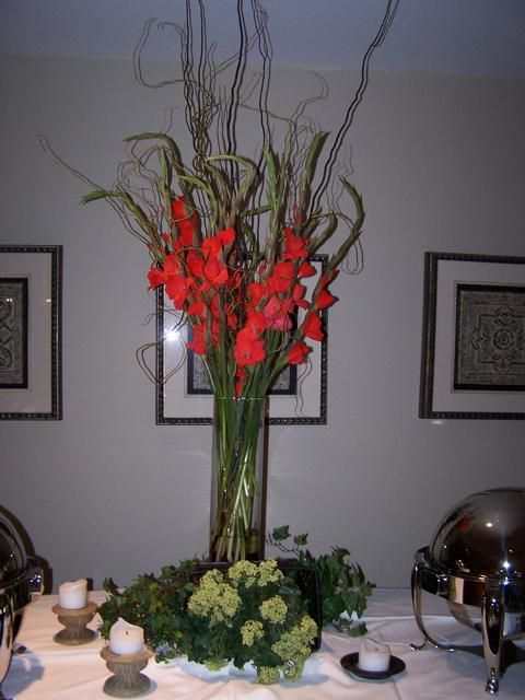 Large arrangement of red gladiolus and curly willow