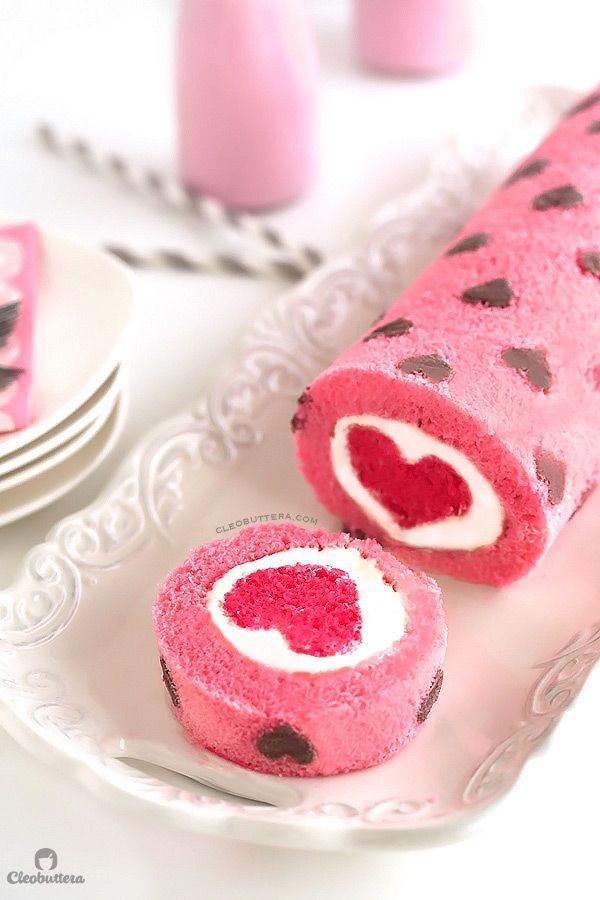 """""""Love is All Around"""" Cake Roll. Heart-patterned cake roll made easier with cake mix, filled with a cloud-like whipped cream cheese frosting, and unveils a cute heart with every slice!"""
