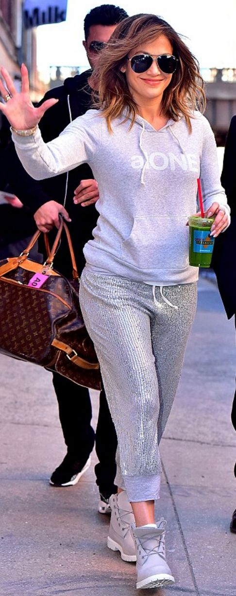 Who made  Jennifer Lopez's gray boots and sequin silver sweatpants?