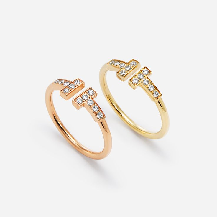 An icon for a new era. Tiffany T wire rings in 18k rose and yellow gold with diamonds.
