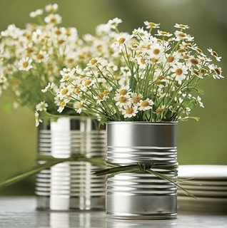 Love this simple and inexpensive centerpiece. Maybe add a little more decoration to the cans but very cute!