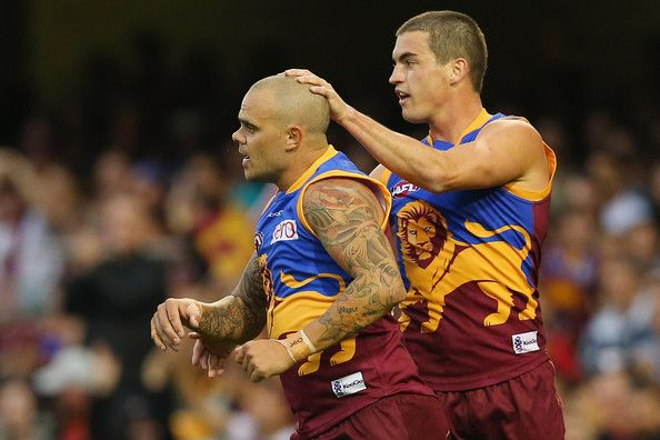 Ashley McGrath of the Lions is congratulated by Tom Rockcliff after kicking a goal during the round 13 AFL match between the Brisbane Lions and the Geelong Cats at The Gabba on June 23, 2013 in Brisbane, Australia.