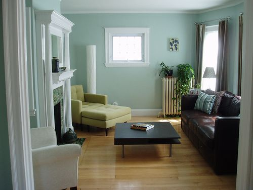 Thick white moulding. Blue walls. Chair and ottoman peaking out from the back. BM Palladian Blue