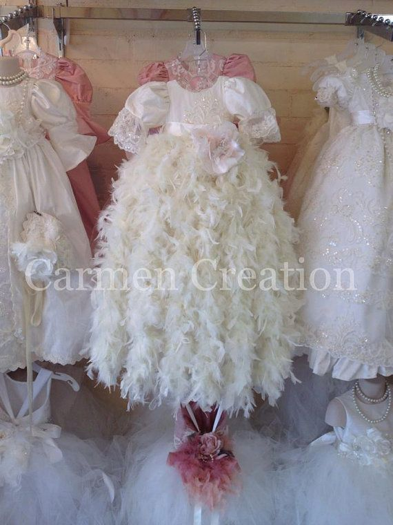 Our Victorian Feather Christening Gown is one of a kind made of fine silk. It can be made any size, and color. We can make it white or ivory, if you have any questions please message us. Headpiece 50.00  Measurements we need for custom orders.  - Chest all around  - Waist all around - Shoulder to hem ( edge of skirt maybe floor length, ankle or T Length its up to you.) Disclaimer:  Be aware that lighting may change colors, photographer styles can do that to images, but we guarantee that your…