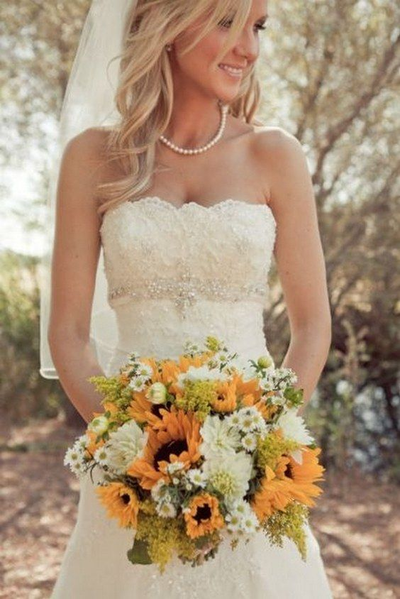 Sunflowers, country wedding bouquet / http://www.himisspuff.com/country-sunflower-wedding-ideas/8/