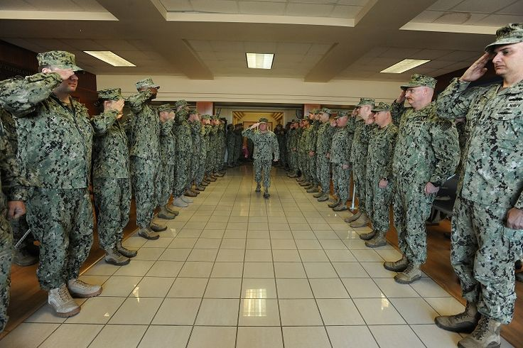 Master Chief John Mulholland, command master chief of Navy Expeditionary Combat Command (NECC), is piped ashore for the last time by sailors from NECC at Joint Expeditionary Base Little Creek-Fort Story. Mulholland served for 32 years.