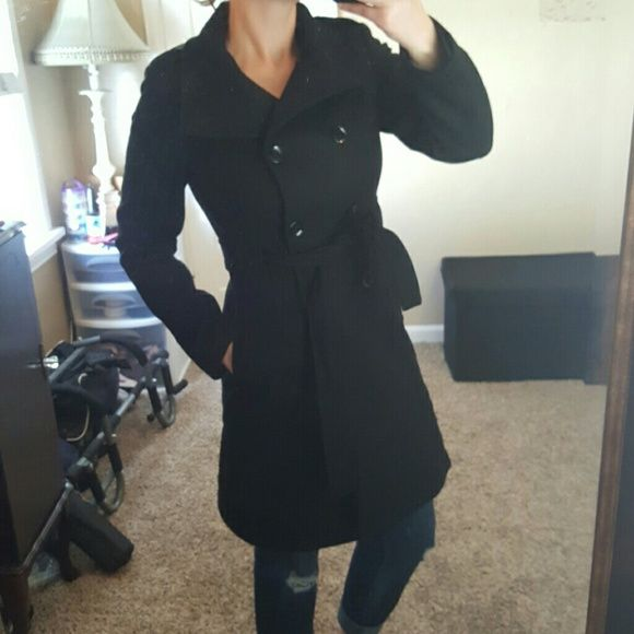 Calvin Klein wool coat Black wool trench/pea coat in almost new condition. High button collar, belted waist. Layered skirted bottom. Heavy weight, thick and warm. Super stylish. Worn a couple times. Size 2 but can fit larger (maybe up to 6), too. NO TRADES. Calvin Klein Jackets & Coats Pea Coats