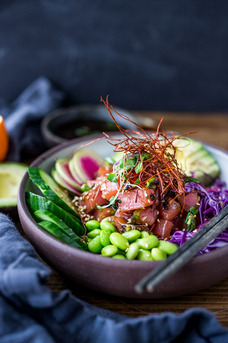 Healthy Poke Bowl- made with ahi tuna (or TOFU!) served over brown rice or kelp noodles, with avocado, cucumber, radish and Citrus Ponzu Sauce!