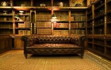 Luxurious Building A Home Library Design With Natural Brown Carving Wooden Wallpaper Bookshelf Mounted On The Wall Be Equipped Storage Shelves Under Bookshelf Also Brown Leather Upholstered Sofa On The Cream Floor Rugs With Library Bookcase  And Home Library Furniture Ideas