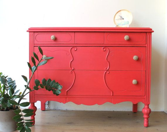 there is no room that would not welcome this little gem painted in a perfect coral colour it is vibrant and fun as a piece of furniture can ever