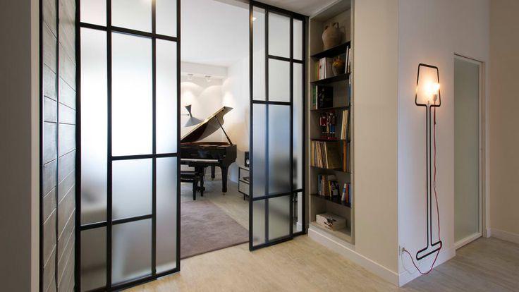 Sfoglia immagini di Soggiorno in stile in stile Industriale e di colore nero : Appartamento al Gazometro. Lasciati ispirare dalle nostre immagini per trovare l'idea perfetta per la tua casa.