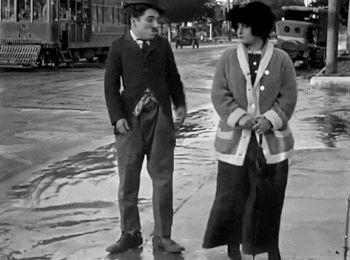 """gifthesilverscreen:  """" Between Showers (1914)  Charlie Chaplin  """""""