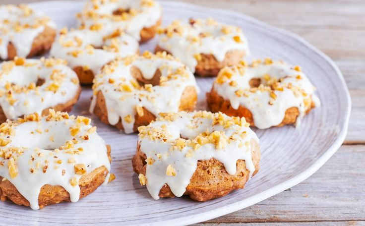 Brighten up your day with ooey-gooey baked banana nut donuts with cream cheese glaze! They're soft, fluffy and the perfect match for your toasty cup of joe.