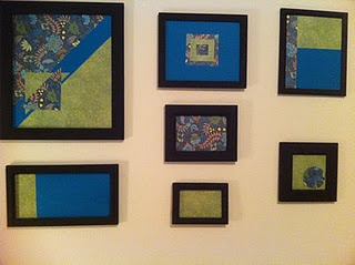 scrapbook paper + painted frames = inexpensive wall art!