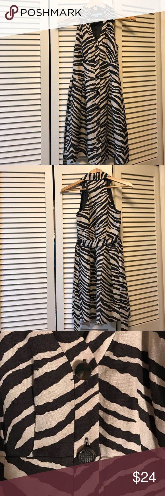 Antonio Melani Size 0 Zebra Print Dress Women's Antonio Melani, size 0, brown and tan zebra print dress. Button up dress, with v neckline, tie waist, and razor back. Missing decorative piece on second button as shown in third picture. ANTONIO MELANI Dresses Midi