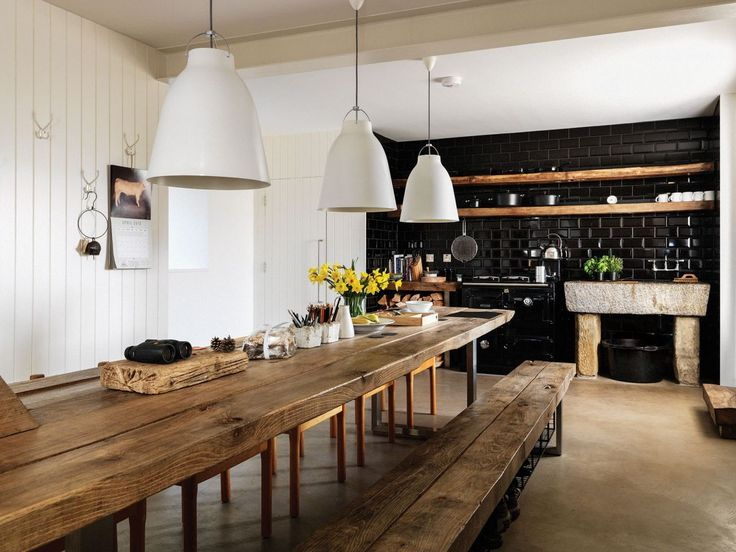 Globally-Inspired Kitchen Design | Product designer Paul Priestman's 17th-century farmhouse is located off the grid on a 200-acre plot in Northumberland, in north-eastern England. In his elemental kitchen, he modernized agrarian design tropes with a streamlined palette and shiny surfaces.