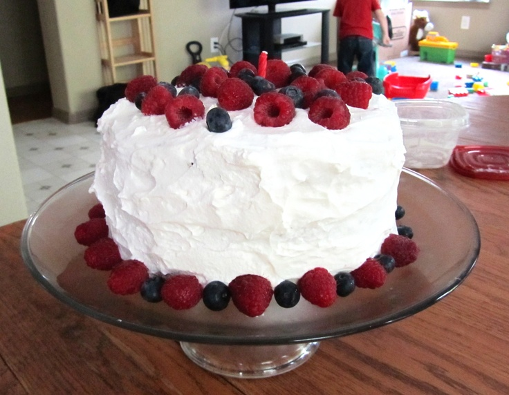 Paula Deen's pound cake recipe baked in 3, 8 inch rounds at 340 for 25 minutes. For the frosting- 2 cups heavy whipping cream beaten with 1tbs vanilla and powder sugar to taste (1 cup). You can see the whip cream has stiff peaks. In between each layer are fresh raspberries (halved) and blue berries, with more for the top and sides. Delicious! Perfect Fourth of July dessert!