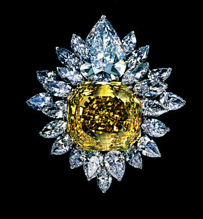 The most extravagant Tiffany & Co. diamond brooch of the twentieth century. The 107-carat canary diamond is surmounted by a 23-carat pear-shaped D-flawless white diamond and surrounded by 80 carats of marquise and pear-shaped white diamonds. Designed by Maurice Galli and John Loring in 1988, it was priced at fifteen million dollars.