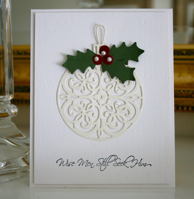 Chrismas card ... clean and simple ... lacey die cut ornament ... white on white with a bit of green holly ... elegant and beautiful ...