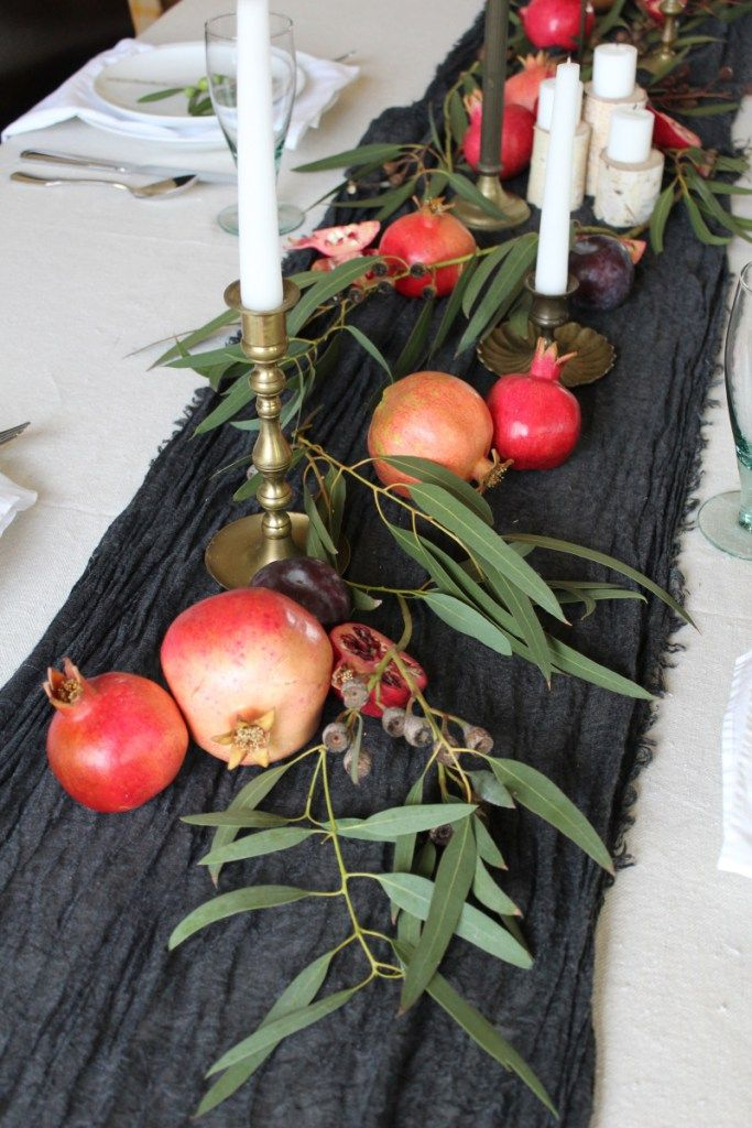Create a centerpiece for any season in 10 minutes using greenery, candles, and seasonal fruit