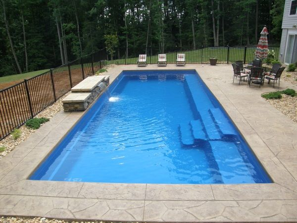 rectangular fiberglass swimming pools design idea unit in large house with concrete edging floor combined with