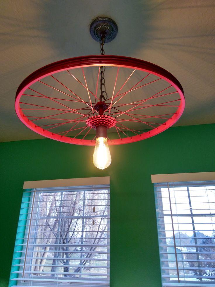 Bike rim light #repurposed this #bike rim to make #update an old light fixure.  #diy