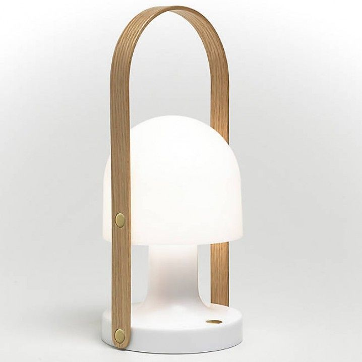 The stunning Follow Me Lamp in Oak, with brass detailing, is a portable and rechargeable table lamp that can be taken wherever you go. Because of its small, warm, and self-contained character, it is ideal both indoors and outdoors. The oak handle beckons you to pick it up. With a swinging lampshade made of white poly-carbonate, it boasts a fresh, luminous look. It comes with LED technology and 3 dimmer settings: Nightlight, Candlelight and Reading Light. The battery is built-in with a USB…