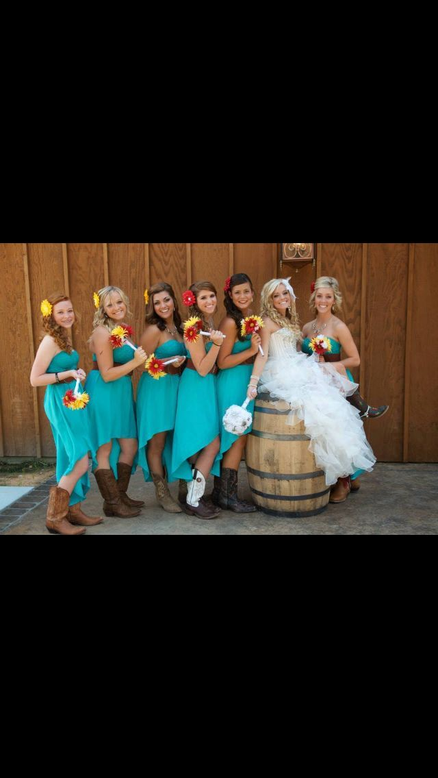 Country wedding. I like the bridesmaids dresses short in front long in back. The belt also matches the boots nicely. Flowers in the hair are pretty too.