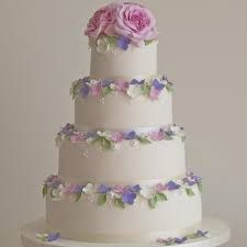 Image result for mixed coloured flowers on wedding cake ideas
