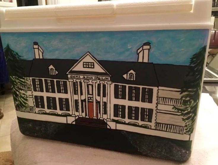 Check out this custom painted frat cooler. This SAE Fraternity house looks amazing!