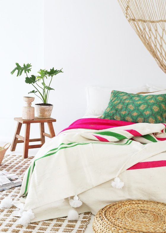 Our handmade Moroccan Pom Pom throw paired fab with our hot pink throw. Styling by the fab @Villastyling