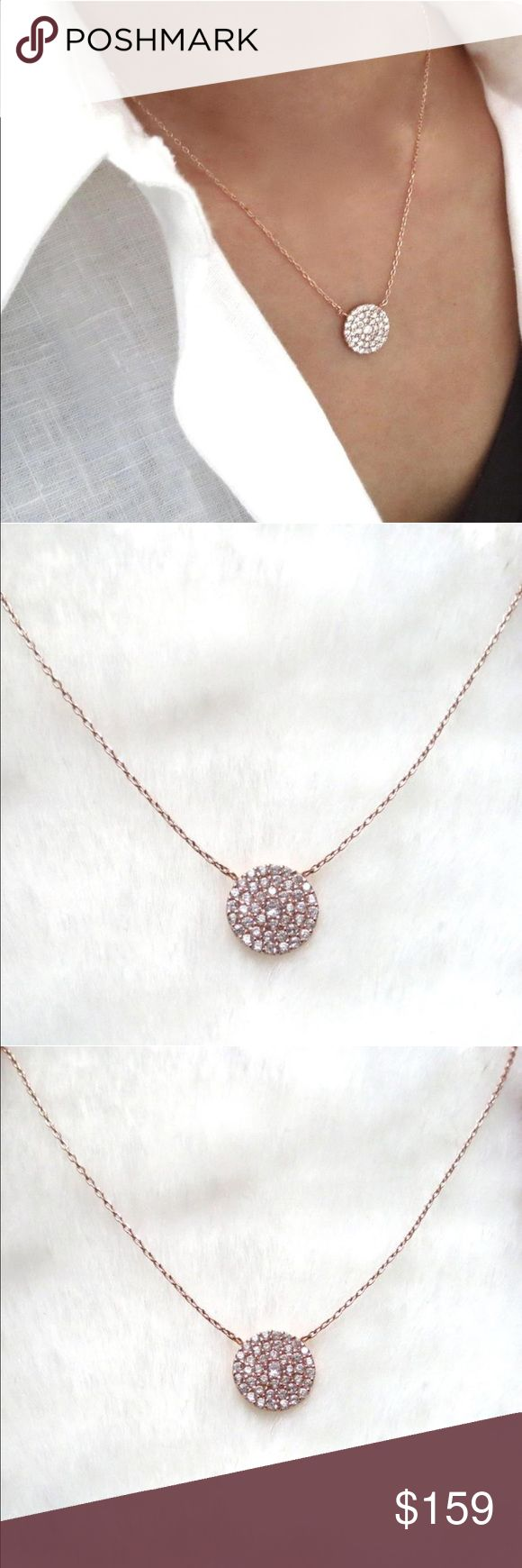Rose gold pavé diamond disc necklace Brand New. Comes in a black velvet pouch. Still currently on elliotfrancis.com for $238. ROSE GOLD PLATED STERLING SILVER PAVE CRYSTAL DISC NECKLACE.  THIS BEAUTIFUL NECKLACE'S FOCAL POINT IS A PAVE DISC FEATURING MORE THAN 40 MICRO CZ FAUX DIAMONDS IN A SETTING  ~  ROSE GOLD PLATED STERLING SILVER  925 STAMPED  SIGNATURE ELLIOT FRANCIS LOGO CHARM  MADE IN ITALY  ~  APPROX 16 INCHES  DISC: 12MM Elliot Francis Jewelry Necklaces