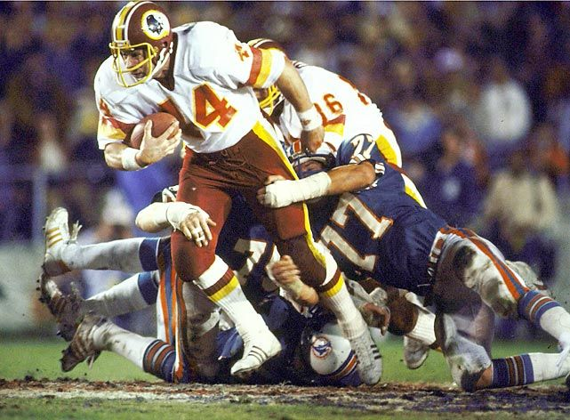 Super Bowl XVII, Jan. 30, 1983 Real men - and hogs - win sooperbowls.  Redskins running back John Riggins powers his way through Miami Dolphins tacklers. Riggins outgained the entire Miami offense with 181 total yards, 166 of them on the ground in the 27-17 win. With his team trailing 17-13 in the fourth quarter, Riggins went 43 yards to the end zone.   Read More: http://sportsillustrated.cnn.com/nfl/photos/1301/100-greatest-super-bowl-photos-of-all-time//70/#ixzz2rN4CyHfE