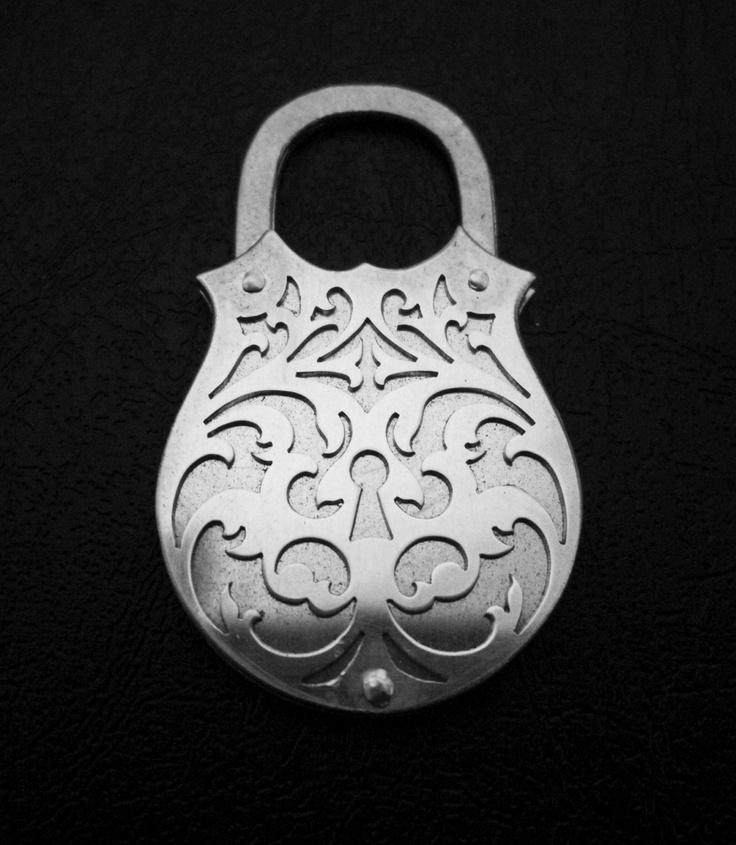 100% Recycled Silver Locket Necklace - Rococo Scrolls Padlock Pendant. $119.00, via Etsy.
