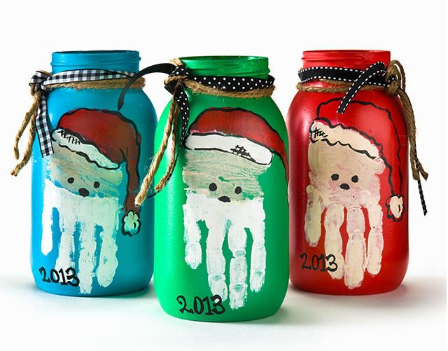 I LOVE these Handprint Art Santa Jars! What a cute way to preserve those tiny handprints! Talk about an easy (and totally adorable) Christmas craft for kids. | AllFreeKidsCrafts.com