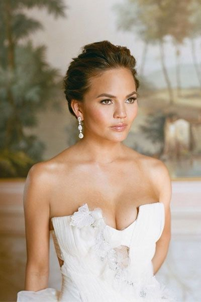 Chrissy Teigen wore three Vera Wang wedding gowns, including this ivory strapless Vera Wang ball gown, to her wedding to John Legend in Italy in 2013.