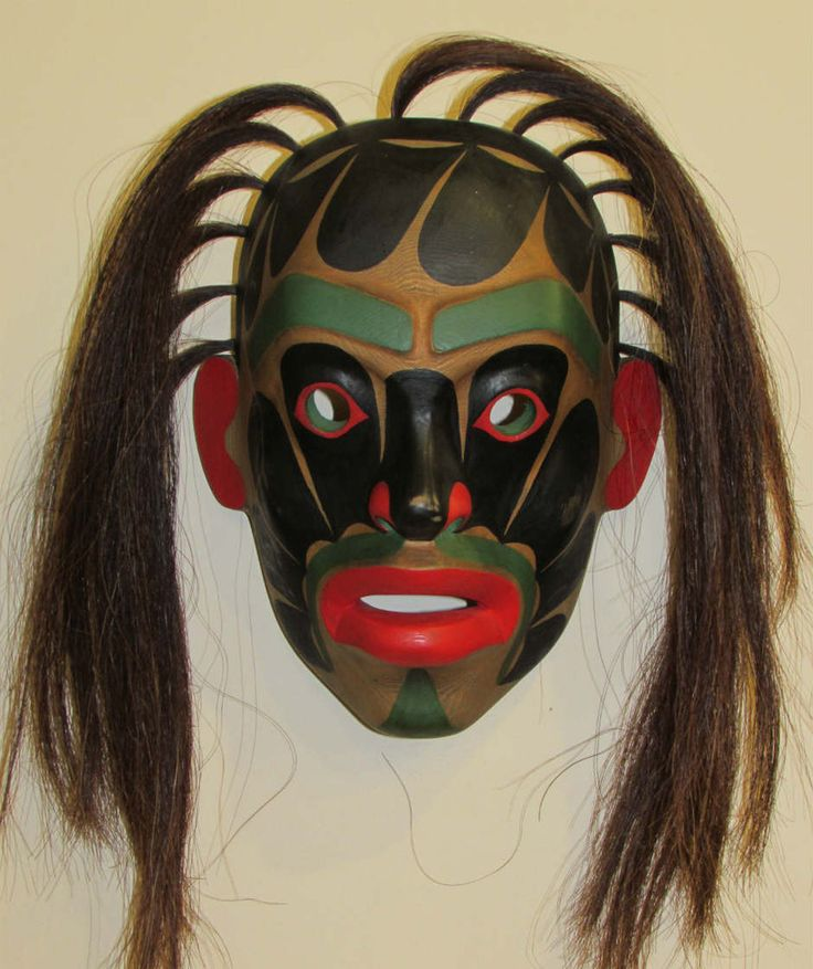 This hand carved mask was created by Beau Dick of the Tsawatainuk First Nation located in Kingcome inlet. This mask represents an ancestor who fell from the heavens. He fell from heaven into the undersea world of #Kumugwe and was able to transform into the different animals to experience Kumugwe's world. When he returned to our world to share his experience, he had a stunned look of wonder on his face, snort running down his face and his eyebrows. Carved out of cedar, horse hair used for…