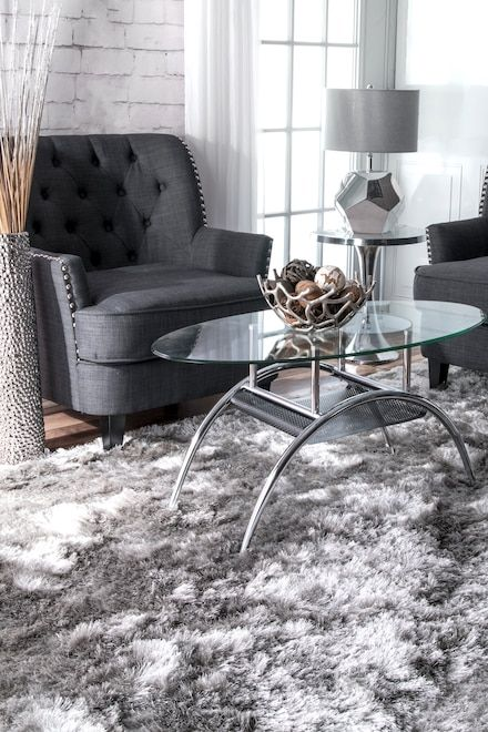Silky Shine Solid Shag Rug: Bring in a sense of warmth and elegance to your home when you lay this solid shag rug in your home. Ideal for high traffic areas too