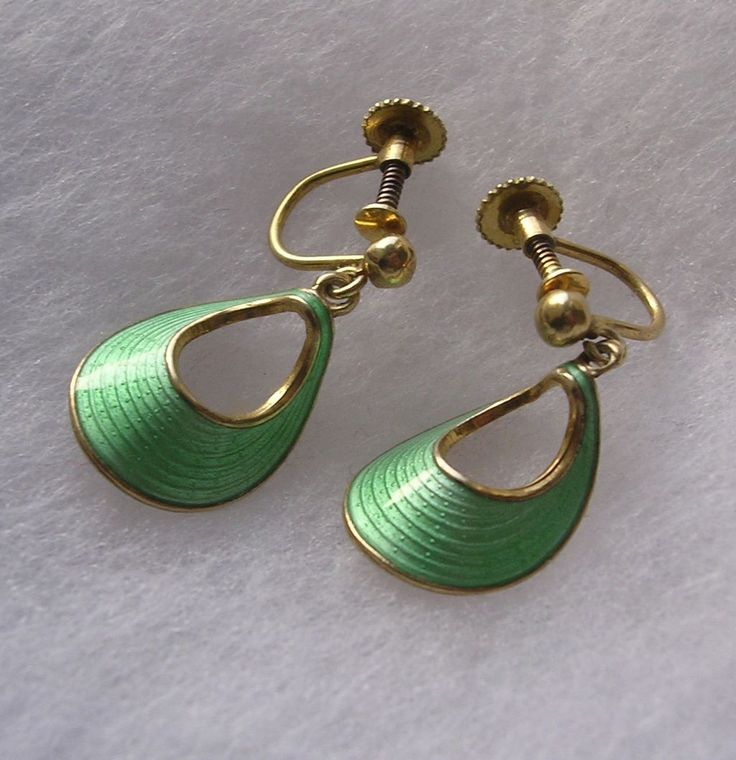 A lovely pair of vintage gilded sterling silver Earrings decorated with apple green guilloche enamel and marked on the back 'Norway Sterling 925 S'