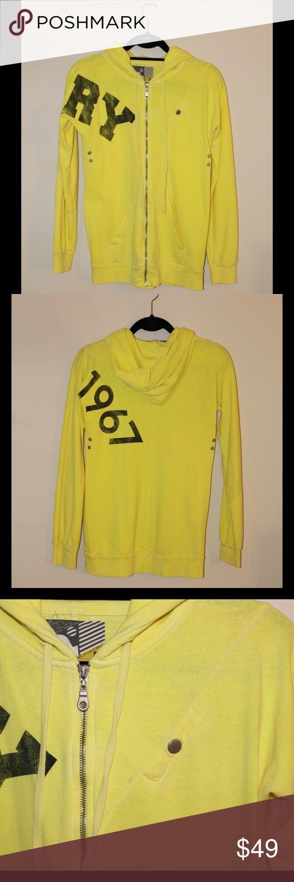 Rebel Yell Neon Yellow Hooded Sweatshirt This is a gently worn, hooded sweatshirt from Rebel Yell. Vintage style print. Zippered front and two front pockets. Small discoloration on front left - shown up close in last picture. Tops Sweatshirts & Hoodies