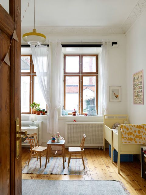 Kids' bedroom inspiration. Light fixture. White curtains. Wood floors. Little table and chairs.