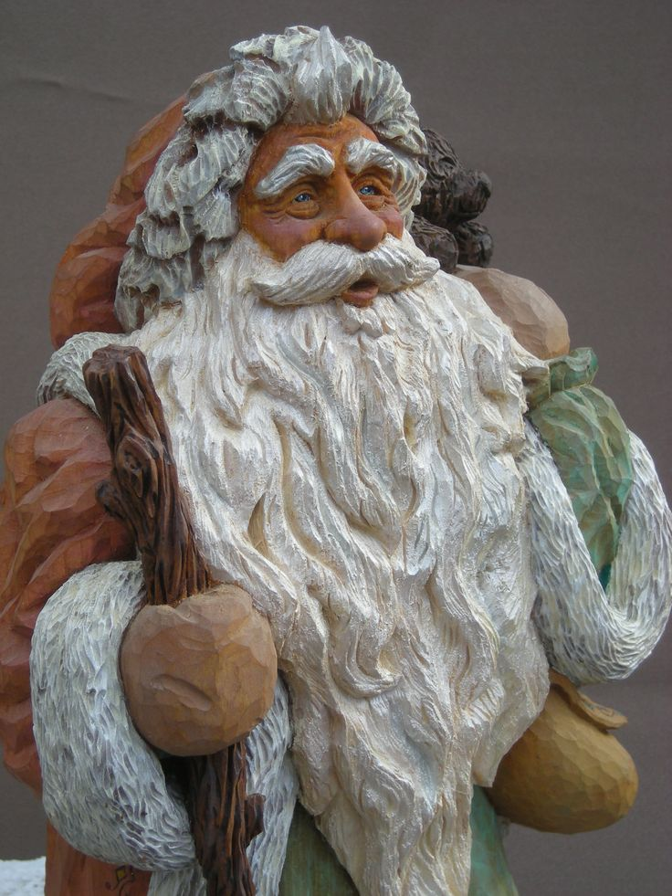 Hand carved santa old world style walking in the by