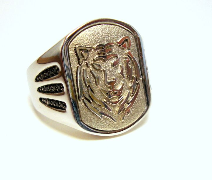 Silver Lion Ring @ http://thesilveroom.com/index.php/collections/mens-jewelry/silver-lion-ring.html
